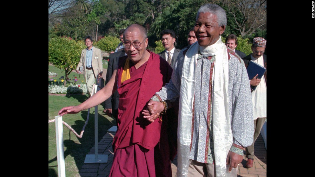"In 1996, the Dalai Lama meets with <a href=""www.cnn.com/2013/03/28/africa/gallery/nelson-mandela/index.html"">Nelson Mandela</a>, the prisoner-turned president who reconciled South Africa after the end of apartheid."