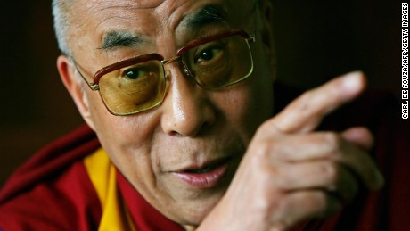 """The Dalai Lama addresses journalists at his hotel in London on May 23, 2008. Prime Minister Gordon Brown held """"very warm and constructive"""" talks with the Dalai Lama Friday, his office said, pledging Britain's full support towards a rapprochement between Tibet and China. The 25-minute meeting -- held at the Archbishop of Canterbury's official residence on the south bank of the River Thames in London -- was the most contentious part of an 11-day visit by the Tibetan spiritual leader. AFP PHOTO/CARL DE SOUZA (Photo credit should read CARL DE SOUZA/AFP/Getty Images)"""