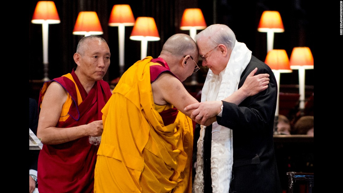 "The Dalai Lama embraces John Templeton after receiving the Templeton Prize during a ceremony at St. Paul's Cathedral in London on May 14, 2012. The award honors ""outstanding individuals who have devoted their talents to expanding our vision of human purpose and ultimate reality."""