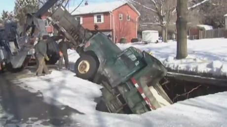 dnt nj sinkhole swallows snow plow truck_00000730.jpg