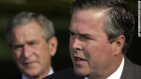 Caption:Washington, UNITED STATES: US President George W. Bush (L) looks on as his brother Florida Governor Jeb Bush speaks 19 April, 2006. Governor Bush was among several governors who met with the president after an Easter trip to Iraq, Afghanistan and Kuwait. AFP PHOTO/Jim WATSON (Photo credit should read JIM WATSON/AFP/Getty Images)