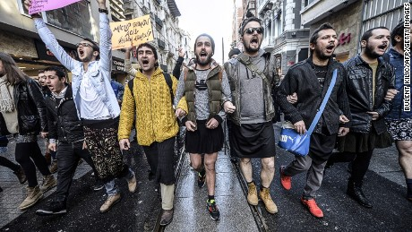Turkish men wearing skirts demonstrate in Istanbul to support women's rights in memory of 20-year-old murdered woman Ozgecan Aslan on February 21, 2015.