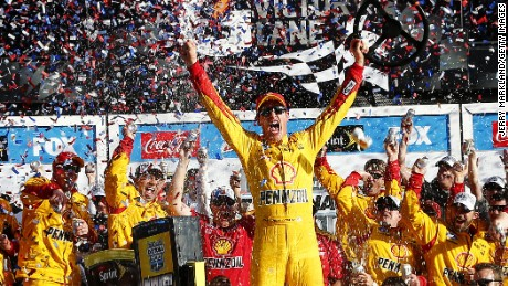 Joey Logano, driver of the #22 Shell Pennzoil Ford, celebrates in victory lane after winning the NASCAR Sprint Cup Series 57th Annual Daytona 500 at Daytona International Speedway on February 22.