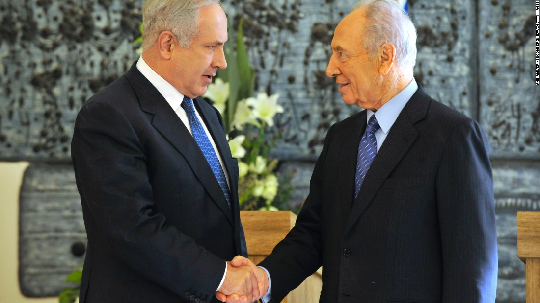 Netanyahu shakes hands with Israeli President Shimon Peres in February 2009 after Netanyahu won backing from the Israeli parliament to become Prime Minister again. A close election between Netanyahu and rival Tzipi Livni had left the results unclear until the parliament's decision.