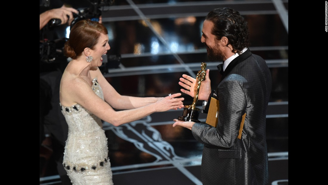 "Matthew McConaughey presents Julianne Moore with the Oscar for best actress at the 87th Academy Awards on Sunday, February 22. She won for her role in ""Still Alice."""