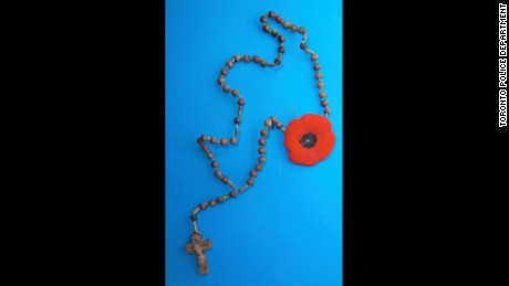 A rosary with a Remembrance Day poppy hung from a nail on the wall of the mysterious Toronto tunnel.