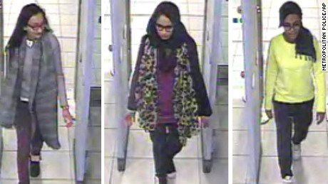 CORRECTING DATE TO MONDAY FEB. 23 - This is three image combo of stills taken from CCTV issued by the Metropolitan Police in London on Monday Feb. 23, 2015, Kadiza Sultana, 16, left, Shamima Begum,15, centre and and 15-year-old Amira Abase going through security at Gatwick airport, before they caught their flight to Turkey on Tuesday Feb 17, 2015. The three teenage girls left the country in a suspected bid to travel to Syria to join the Islamic State extremist group.(AP Photo/Metropolitan Police) NO ARCHIVE