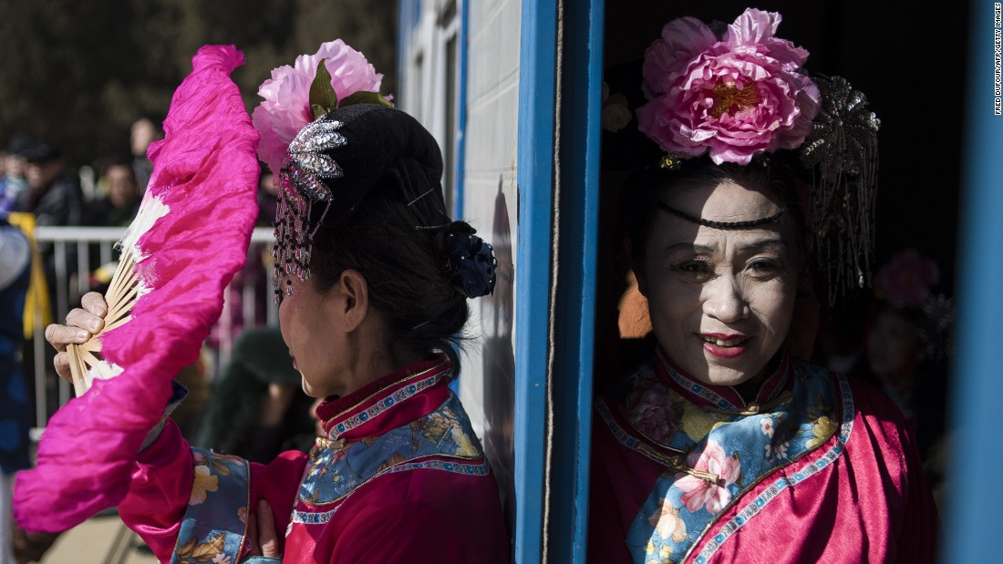 "FEBRUARY 25 - BEIJING, CHINA: Women wearing traditional costumes wait prior to a show at Ditan Park temple fair during the <a href=""http://cnn.com/2015/02/08/asia/gallery/lunar-new-year-2015/"">Chinese Lunar New Year.</a> Millions of Chinese are celebrating the Spring Festival, the most important holiday on the country's calendar, which marks the beginning of the <a href=""http://cnn.com/2015/02/12/asia/year-of-the-goat-sheep-ram/"">Year of the Sheep</a> in 2015."