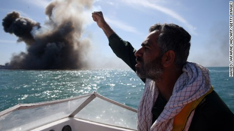 A member of the Revolutionary Guards chants slogans after attacking the vessel.