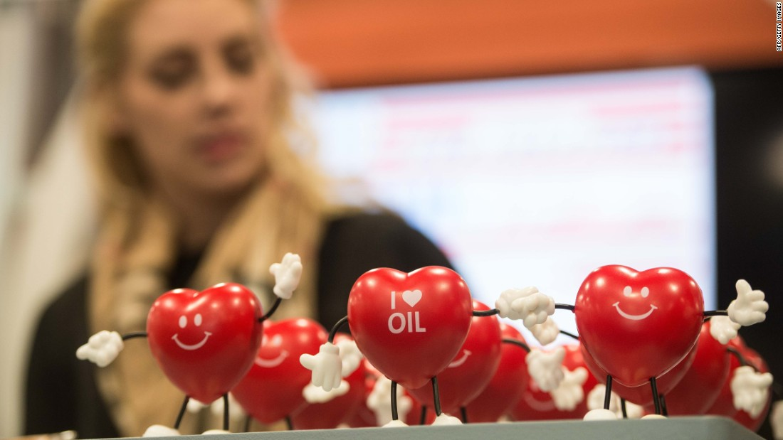 A woman works at a stand promoting the oil industry.