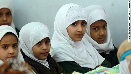 Yemeni schoolgirls attend a class in 2015 in the capital Sanaa.