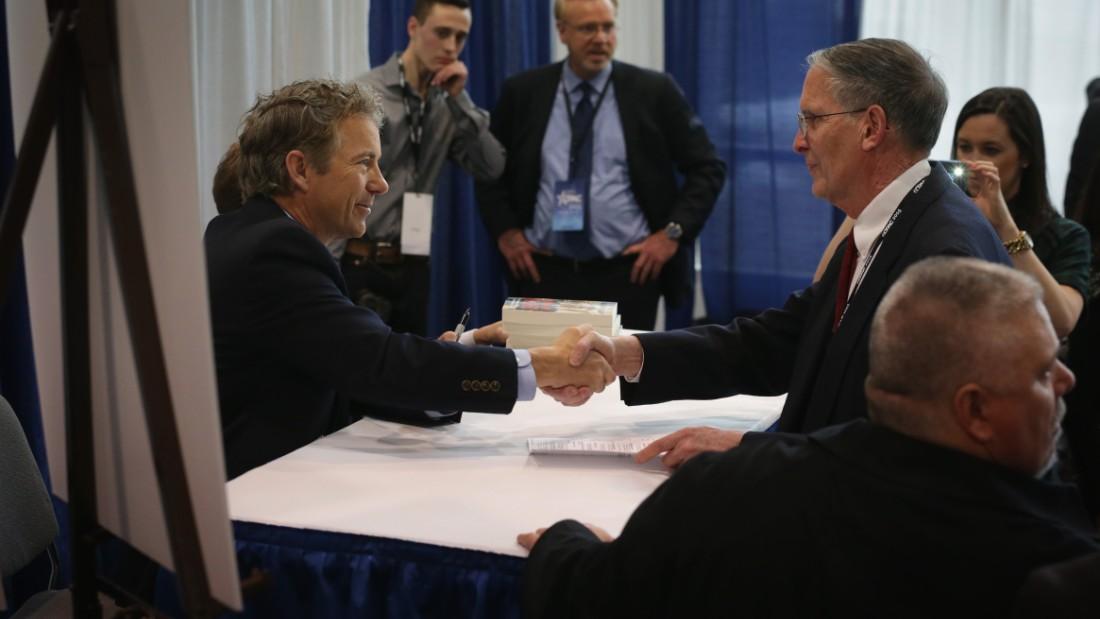 Rand Paul signs books at CPAC.