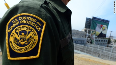 A US Border Patrol agent stands near a crossing to Mexico