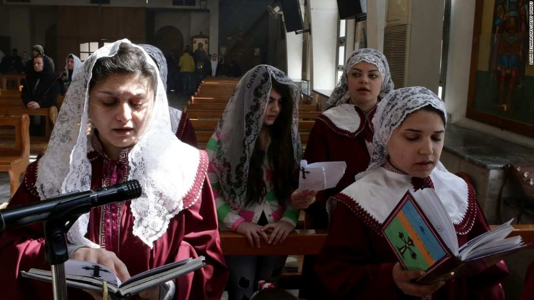 Displaced Assyrian women who fled their homes due to ISIS attacks urge during a church on a hinterland of Damascus, Syria, on Sunday, Mar 1. ISIS militants abducted during slightest 220 Assyrians in Syria.