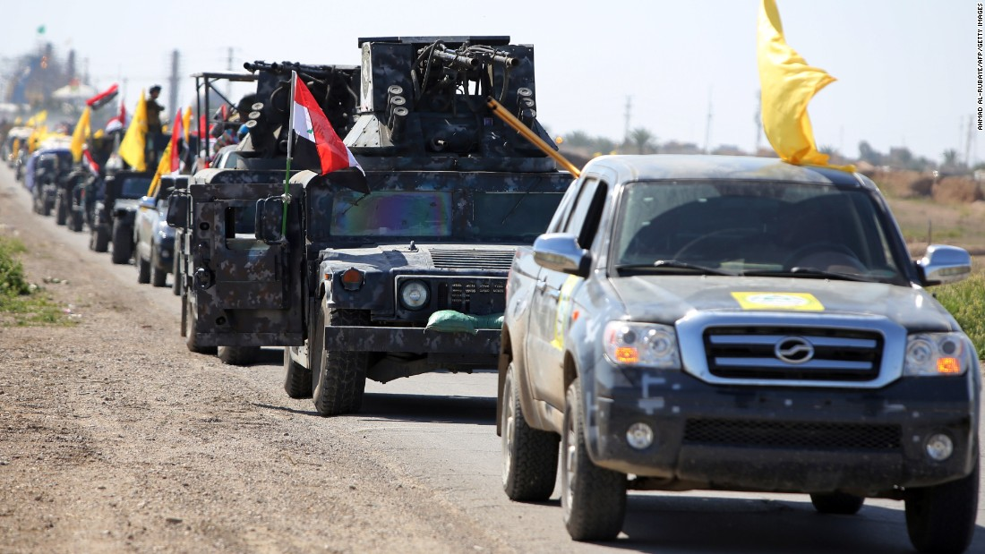 Members of the Iraqi security forces leave Samarra, Iraq, north of Baghdad, on Saturday, February 28, to drive toward Tikrit to launch an assault against ISIS.