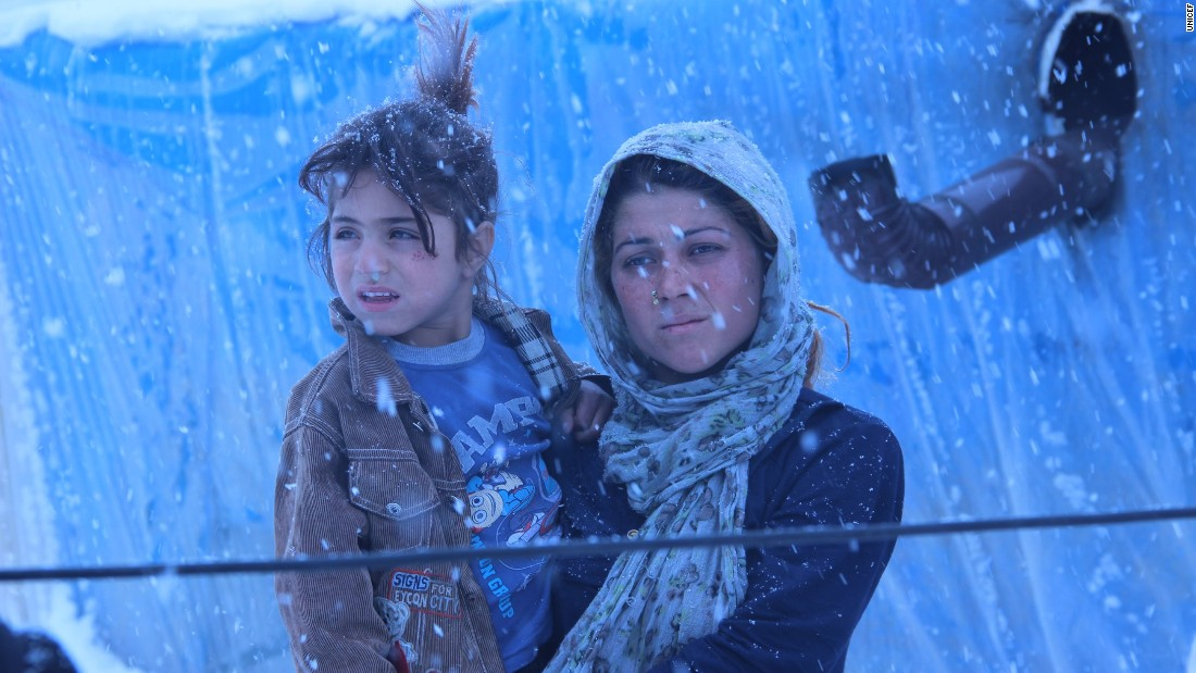 """Winter makes daily life harder in Turkey's refugee settlements, especially for children who lack winter clothing. UNICEF says more than half of all Syrian refugees are children. This young woman whispered to the photographer, """"Send warm clothes, please."""""""