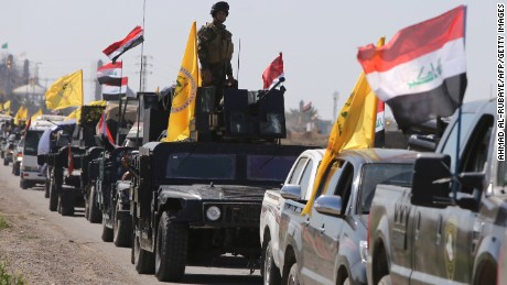 Members of the Iraqi security forces heading from the city of Samarra north of Baghdad drive towards al-Dawr area south of Tikrit to launch an assault against the Islamic State group (IS) on February 28, 2015.
