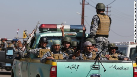 Members of the Iraqi security forces coming from the city of Samarra, north of Baghdad, drive towards al-Dawr area located south of Tikrit to launch an assault against the Islamic State group (IS) on February 28, 2015.