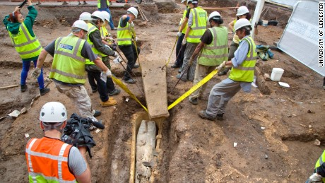 Archaeologists remove the coffin's stone lid --  revealing a second, lead coffin -- in the summer of 2013.