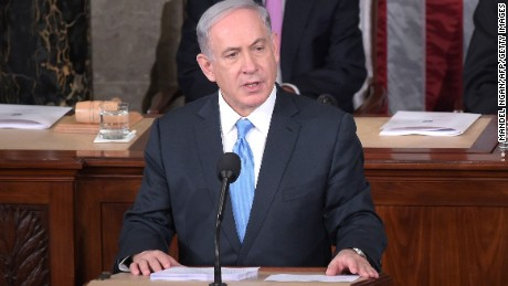 Israel's Prime Minister Benjamin Netanyahu addresses a joint session of the US Congress on March 3, 2015 at the US Capitol in Washington, DC. Netanyahu was invited by House Speaker John Boehner to address Congress without informing the White House. Looking on are House Speaker John Boehner(L) and  President pro tempore of the Senate Sen. Orrin Hatch.AFP PHOTO/MANDEL NGANMANDEL NGAN/AFP/Getty Images