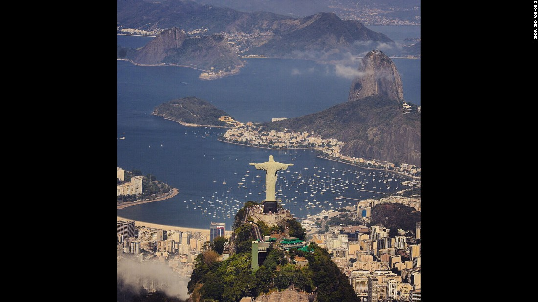 "BRAZIL: ""Cristo Redentor -- better known to English speakers as Christ the Redeemer -- looks out over Sugarloaf Mountain and the rest of the stunning Rio de Janeiro coastline. A helicopter ride allows you to escape the crowds at the statue itself, and fully appreciate its dominance of the city."" - CNN's Nicol Nicolson.<a href=""http://flipagram.com/f/RitXjzxaFY"" target=""_blank""><br />Watch Nicol's narrated FLIPAGRAM</a> about his travels in Brazil.<br /><br />Follow @nicolnic  and other CNNers on the @cnnscenes gallery on Instagram for more images you don't always see on news reports from our teams around the world."