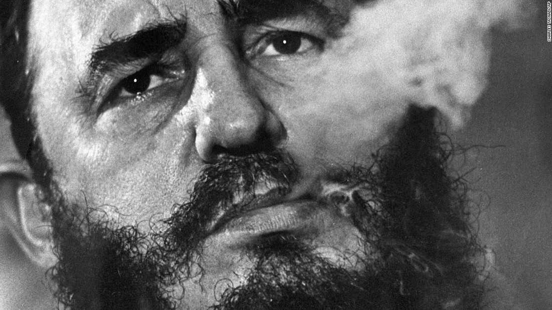 Fidel Castro exhales cigar smoke during a March 1985 interview at his presidential palace in Havana, Cuba. Click through the gallery to see more photos from his life: