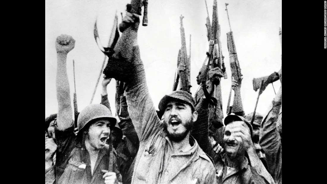 Castro and the revolutionaries hold up their rifles in January 1959 after overthrowing Batista.