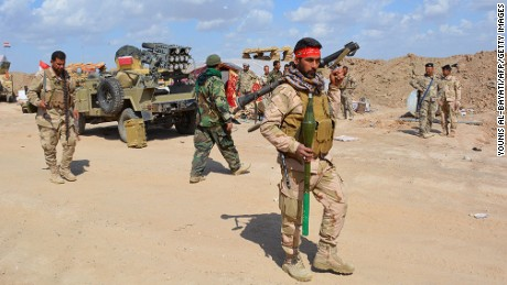 Iraqi government forces and allied militias take position in northern Diyala Province as they take part in an assault to retake the city of Tikrit from ISIS on March 2, 2015.