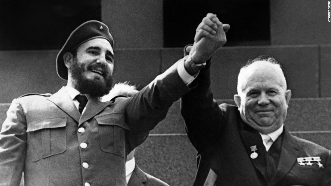 Castro holds the hand of Soviet leader Nikita Khrushchev during a four-week visit to Moscow in May 1963.