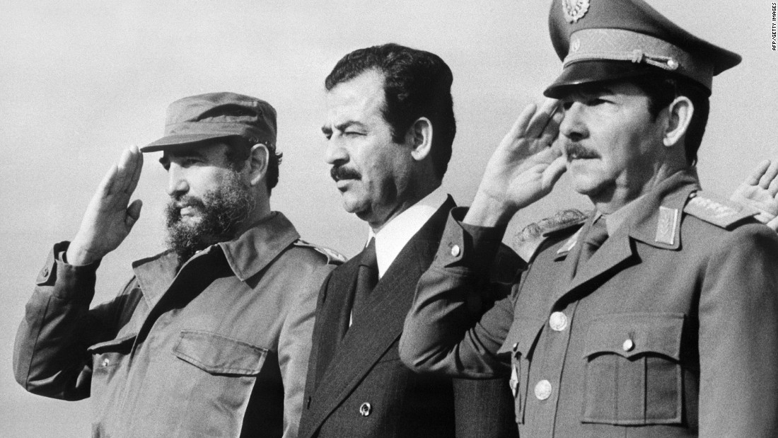 Iraqi Vice President Saddam Hussein, center, stands with the Castro brothers during a visit to Cuba in January 1979.