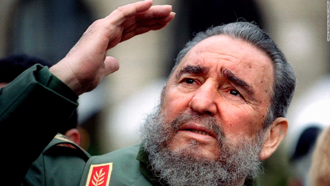 Castro gestures during a tour of Paris in March 1995.