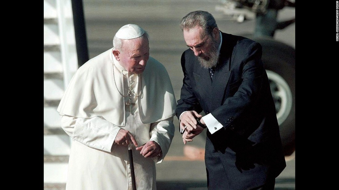 Castro walks with Pope John Paul II on an airport tarmac in Havana in January 1998. It was the first time a pope had ever visited Cuba.