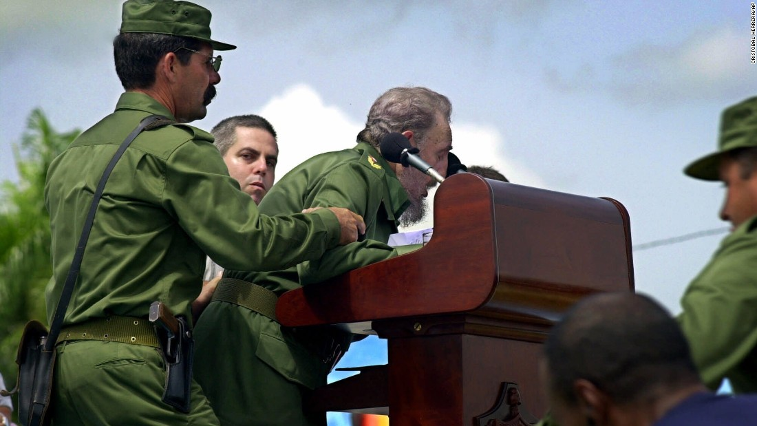 Castro is helped by aides after he appeared to faint two hours into a speech in Cotorro, Cuba, in June 2001. He returned to the podium less than 10 minutes later to assure the audience he was fine and that he just needed to get some sleep.