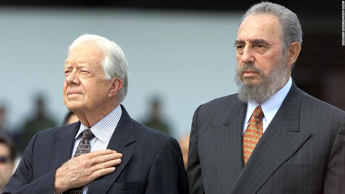 Castro and former U.S. President Jimmy Carter listen to the U.S. national anthem after Carter arrived in Havana for a visit in May 2002.