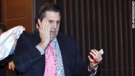 U.S. Ambassador to South Korea Mark Lippert leaves a lecture hall for a hospital in Seoul, South Korea, Thursday, March 5, 2015.