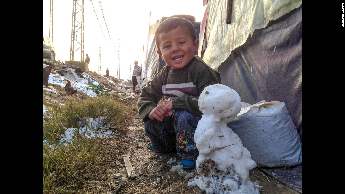 "LEBANON:  A young Syrian refugee proudly presents his snowman at a makeshift refugee camp in Bekaa Valley.  Photo by CNN's Christian Streib, December 2013. <br />Follow <a href=""http://instagram.com/christianstreibcnn"" target=""_blank"">@christianstreibcnn</a> and other CNNers on the <a href=""http://instagram.com/cnnscenes"" target=""_blank"">@cnnscenes</a> gallery on Instagram for more images you don't always see on news reports from our teams around the world."