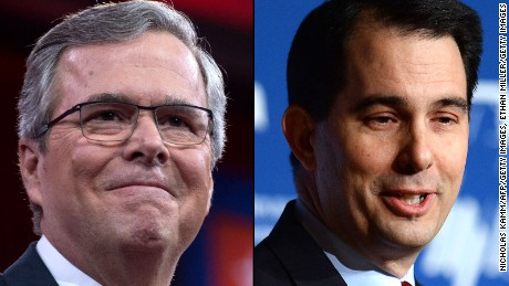 Former Florida Gov. Jeb Bush, left, and Wisconsin Gov. Scott Walker