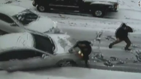 pkg car slides in snow hits person_00001302.jpg