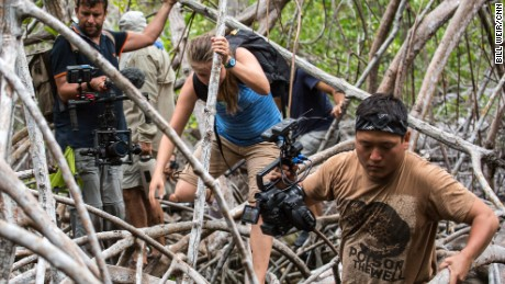 The crew of The Wonder List with Bill Weir navigates a mangrove swamp while filming in the Galapagos.