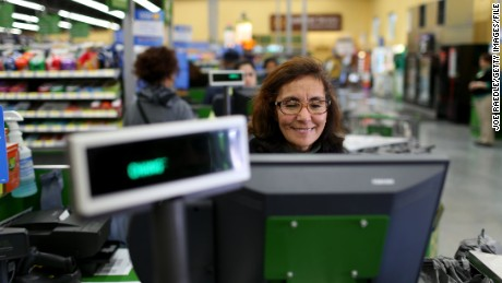 MIAMI, FL - FEBRUARY 19: Walmart employee Blanca Mojita rings up a customers purchases at a Walmart store on February 19, 2015 in Miami, Florida. The Walmart company announced Thursday that it will raise the wages of its store employees to $10 per hour by next February, bringing pay hikes to an estimated 500,000 workers. (Photo by Joe Raedle/Getty Images)