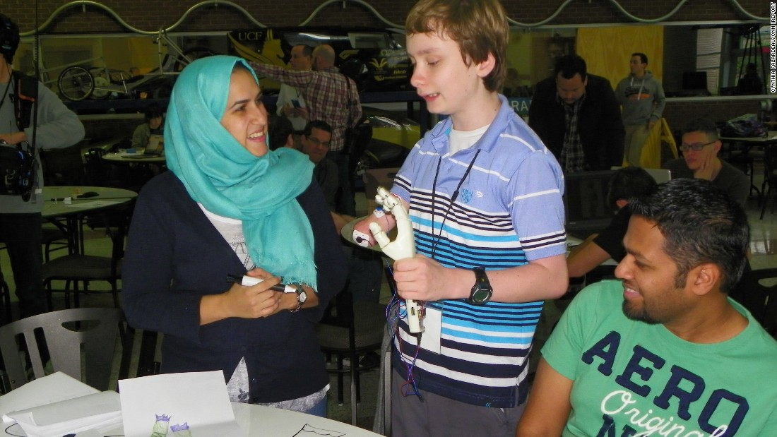 An engineering student chats with Wyatt about her design.