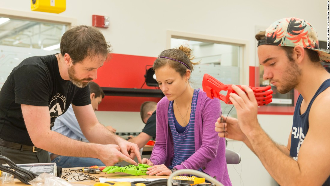 """Ivan Owen, co-designer of the first 3D printed prosthetic hand and a designer for the <a href=""""http://enablingthefuture.org/"""" target=""""_blank"""">E-Nable community</a>, instructs students at a Build-a-Thon at the University of Central Florida. The students produced 60 robotic hands for a pediatric rehab clinic in San Antonio, Texas."""