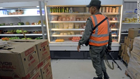 Member of national guard patrols a supermarket in Caracas, on February 3, 2015.