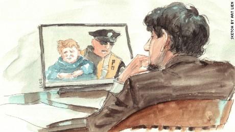 Dzhokhar Tsarnaev during testimony of Officer Thomas Barrett, who picked up Leo, 3, after Boston Marathon bombing.