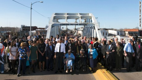 President Barack Obama, first lady Michelle Obama, Malia and Sasha as well as members of Congress and civil rights leaders make a symbolic walk across the Edmund Pettus Bridge, on Saturday, March 7 in Selma, Alabama.