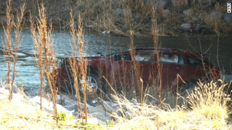 The car was partly submerged in the frigid Spanish Fork River.