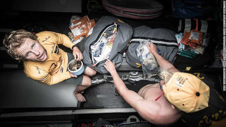 "Sailors Luke ""Parko"" Parkinson and Alex Higby raid the spare food bags during leg 4, between China and New Zealand."