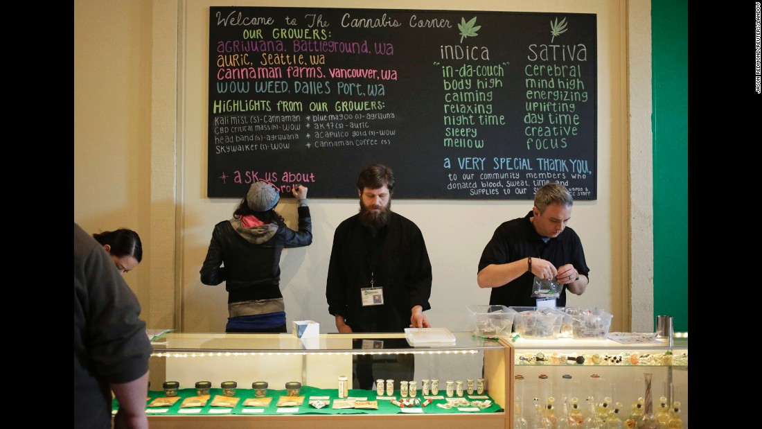 Employees make last-minute preparations before the grand opening of the Cannabis Corner in North Bonneville, Washington, on March 7, 2015. The pot shop is the first city-owned recreational marijuana store in the country.