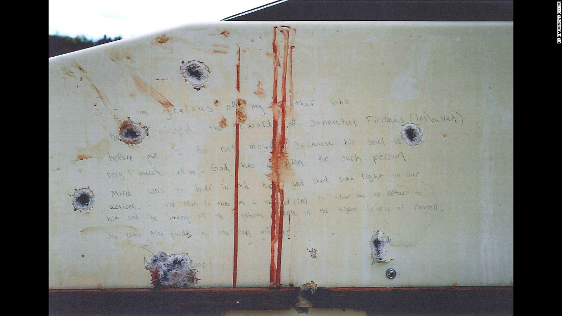 Prosecutors showed the jury photos of what they say are Tsarnaev's writings on the inside of the boat he was captured in.