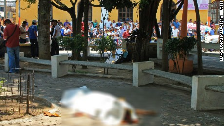 View of the body of journalist Federico Salazar, of Nuevo Mundo, who was murdered by unknown assailants in the central park of Mazatenango municipality, Suchitepequez departament 170 km south Guatemala City on March 10, 2015. Salazar was killed along with Danilo Lopez, of Prensa Libre, whilst journalist Marvin Tunches was wounded and was taken to a local hospital, local media reported.